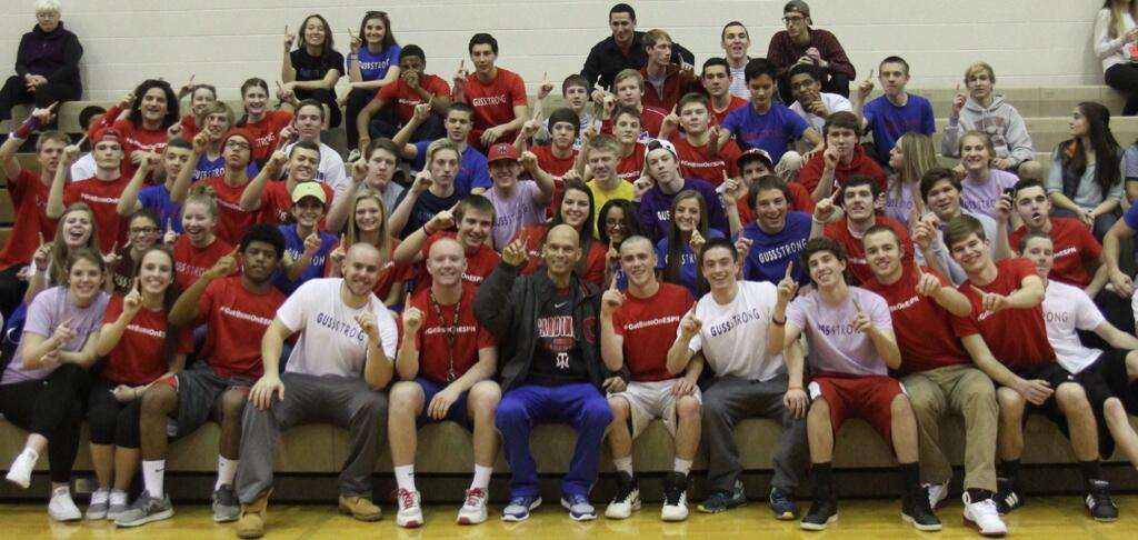 Students gather around Gussler during halftime of a 2013-14 Thomas Worthington basketball game.
