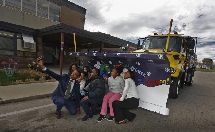 Columbus City Council member Shannon Hardin, left, takes a selfie with 4th and 5th grade artists from Duxberry Elementary School that painted a snowplow blade. City Council member Jaiza Page is on the right. (Columbus Dispatch photo by Tom Dodge)