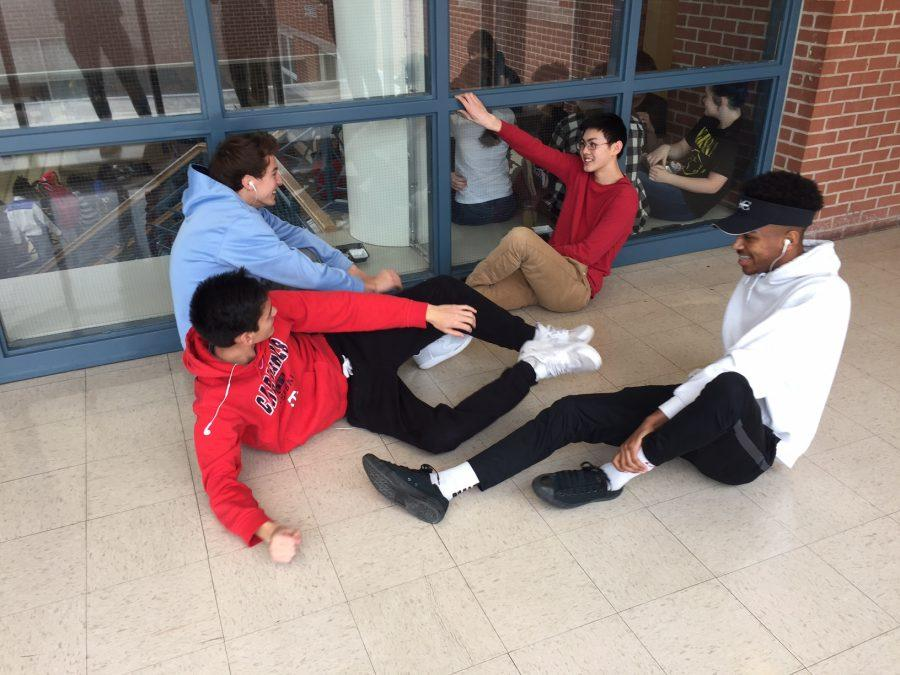 A bunch of goons mess around in the hallways.