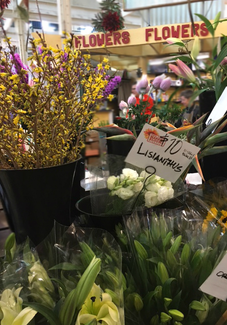 At the North Market vendors sell a variety of products, including flowers.