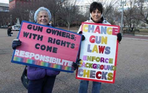 Two women protesting gun laws by stating how they feel towards them. Curtsy of Flickr