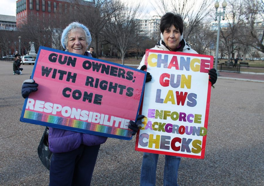 Two+women+protesting+gun+laws+by+stating+how+they+feel+towards+them.+Curtsy+of+Flickr+