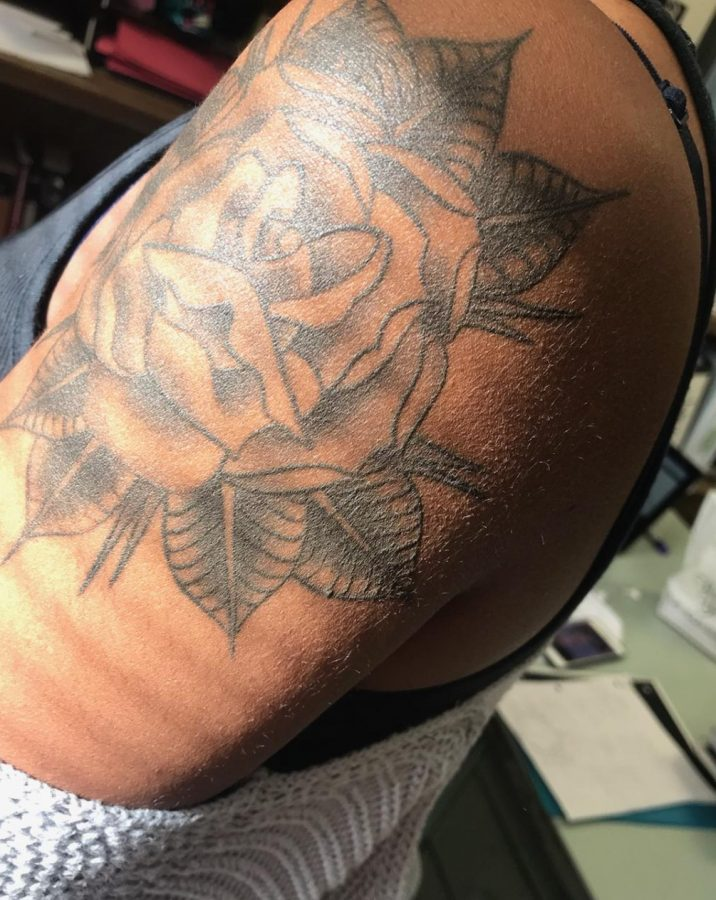 A tattooed rose adorns the shoulder of Senior Indy McCross.