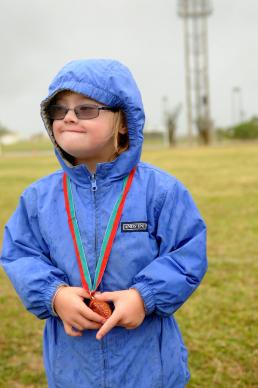 Seven-year-old Marlee McDaniel poses with her medal at Kadena Special Olympics on Nov. 17, 2012.