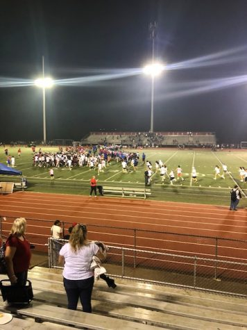 The Thomas Worthington student section runs down onto the field after the Cardinals beat Kilbourne on September 20th.
